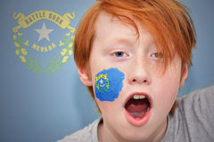 Redhead fan boy with nevada state flag painted on his face. Stock Photos