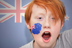 Redhead fan boy with new zealand flag painted on his face Stock Photos