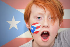 Redhead fan boy with puerto rican flag painted on his face Royalty Free Stock Images