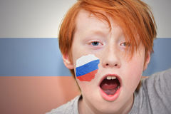 Redhead fan boy with russian flag painted on his face Royalty Free Stock Photography
