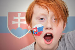 Redhead fan boy with slovak flag painted on his face Stock Photos