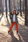 Redhead fashionable woman in the forest Stock Photo