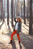 Redhead fashionable woman in the forest Stock Images