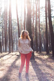 Redhead fashionable woman in the forest Stock Photography