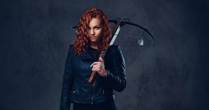 Redhead female  holds crossbow. Royalty Free Stock Photography