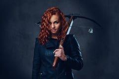 Redhead female  holds crossbow. Stock Photo