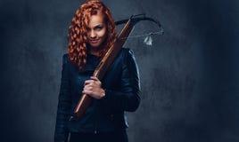 Redhead female  holds crossbow. Stock Photos
