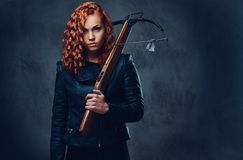 Redhead female  holds crossbow. Stock Images