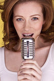 Redhead female singer. Royalty Free Stock Photography