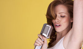 Redhead female singer. Stock Photo