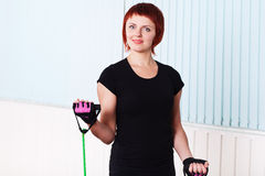 Redhead fitness woman doing exercise with expander Royalty Free Stock Image