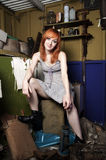 Redhead girl. Pretty young woman at damage shed holding oil lamp Stock Photos