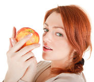 Redhead girl with apple. On white background Royalty Free Stock Photo