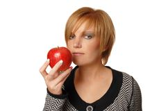 Redhead girl with apple Stock Image