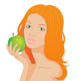 Redhead girl with an apple. Beautiful Redhead girl holding a green apple Stock Photo
