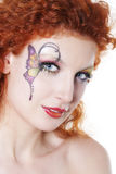 Redhead girl with art makeup Royalty Free Stock Images