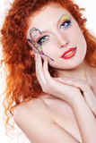 Redhead girl with art makeup. Portrait of redhead girl with art makeup and painted butterfly Royalty Free Stock Image
