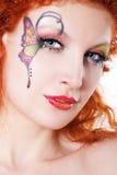 Redhead girl with art makeup Stock Image
