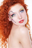 Redhead girl with art makeup. Portrait of redhead girl with art makeup and painted butterfly Stock Photo