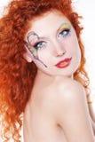 Redhead girl with art makeup Stock Photo