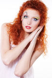 Redhead girl with art makeup. Portrait of redhead girl with art makeup and painted butterfly Stock Image