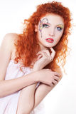 Redhead girl with art makeup Stock Image