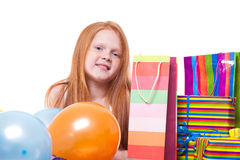 Redhead  girl with balloons and gift box Royalty Free Stock Photo