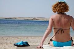 Redhead girl on beach royalty free stock photography