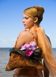 Redhead girl on the beach. With floral handbag Royalty Free Stock Photos