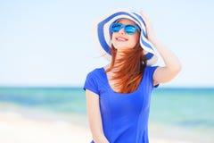 Redhead girl on the beach Stock Photo