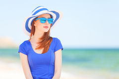 Redhead girl on the beach Stock Image