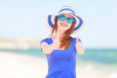 Redhead girl on the beach Stock Photography