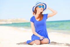 Redhead girl on the beach Stock Photos