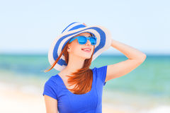 Redhead girl on the beach Royalty Free Stock Images