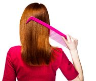 Redhead girl with big comb royalty free stock photos