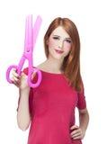 Redhead girl with big scissors Stock Photos