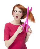 Redhead girl with big scissors Royalty Free Stock Photography