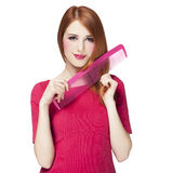 Redhead girl with big scissors Royalty Free Stock Photos