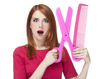 Redhead girl with big scissors and comb Stock Photo