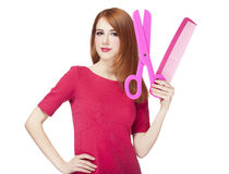 Redhead girl with big scissors and comb Stock Photography