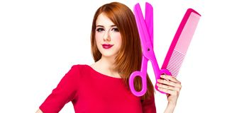 Redhead girl with big scissors and comb royalty free stock photos