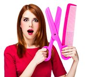 Redhead girl with big scissors and comb stock image