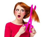 Redhead girl with big scissors royalty free stock images