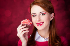 Redhead girl with cake. Stock Photo