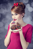 Redhead girl with cakes for St. Valentine Day. Stock Image