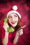 Redhead girl calling to Santa. Stock Image