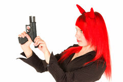 Redhead girl charging a gun. Isolated on white Stock Photos