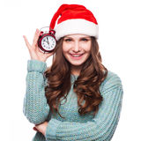 Redhead girl in christmas hat with clock Stock Images