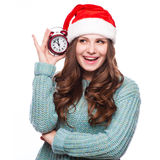 Redhead girl in christmas hat with clock Stock Photography