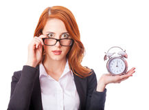 Redhead girl with clock Royalty Free Stock Images